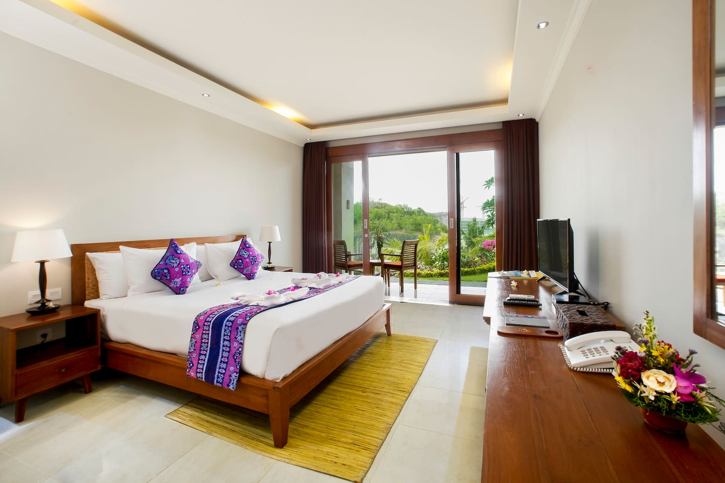 This is Deluxe room at Puri Pandawa Resort. We have 4 unit of this type. The image show us Bedroom, Flat TV,  Telephone, View from the room, chair at the terrace, and other amenities.