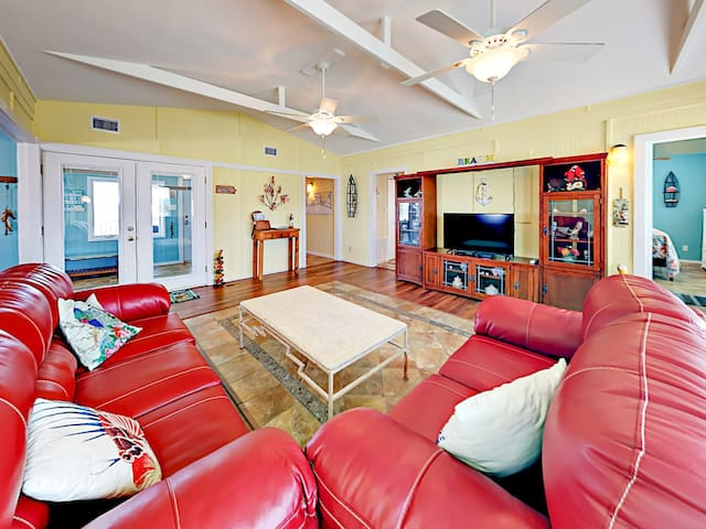 "Sprawl out on 2 red leather sofas and enjoy a movie on the 42"" flat screen TV."
