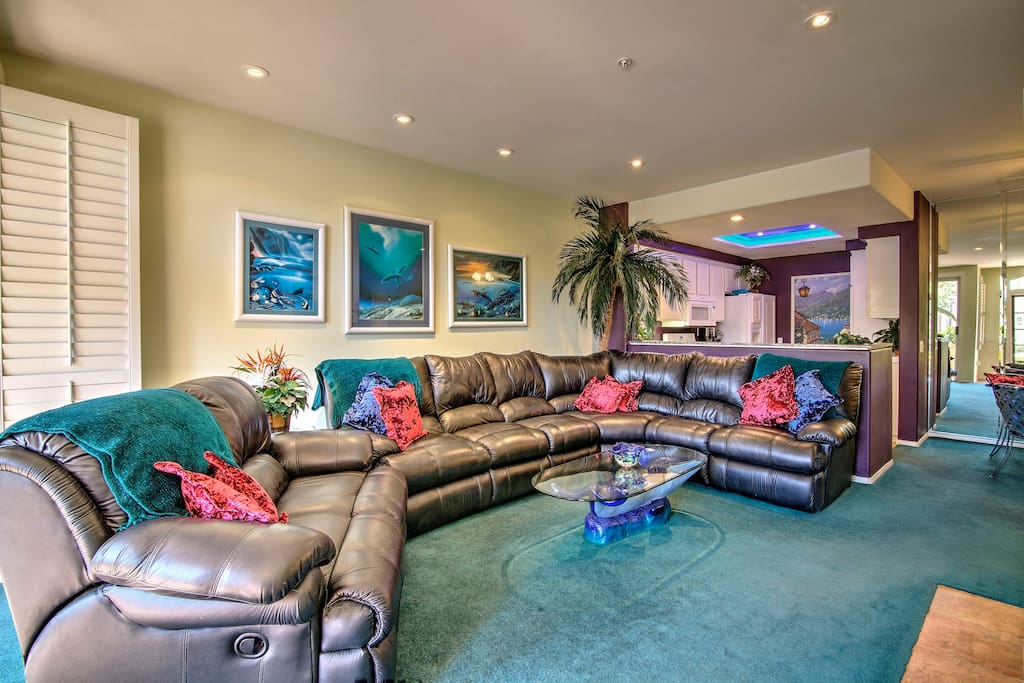 Lounge on the spacious couch and enjoy a movie on the flat-screen TV.