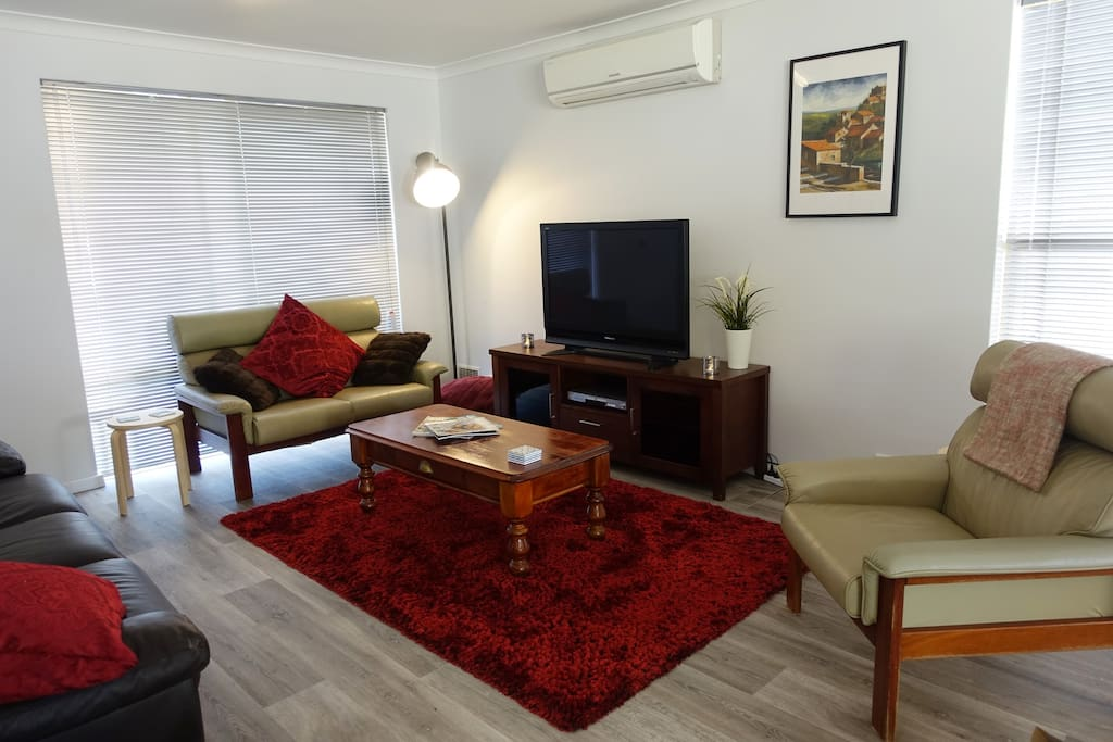 "Comfortable Living room with airconditioning and electric ""fire"" (and sofa bed). Seating for 8 guests to relax."
