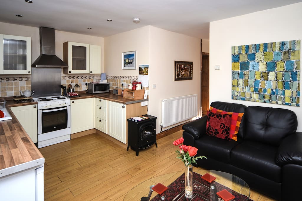 open plan kitchen wihich is fully equipped. Electric cooker, microwave, washing machine and fridge.