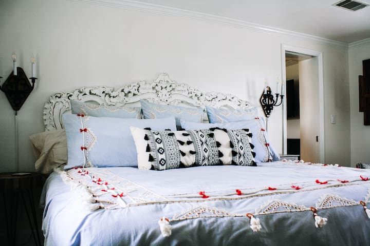 Beautiful king sized bed with luxury linens in the private bedroom.