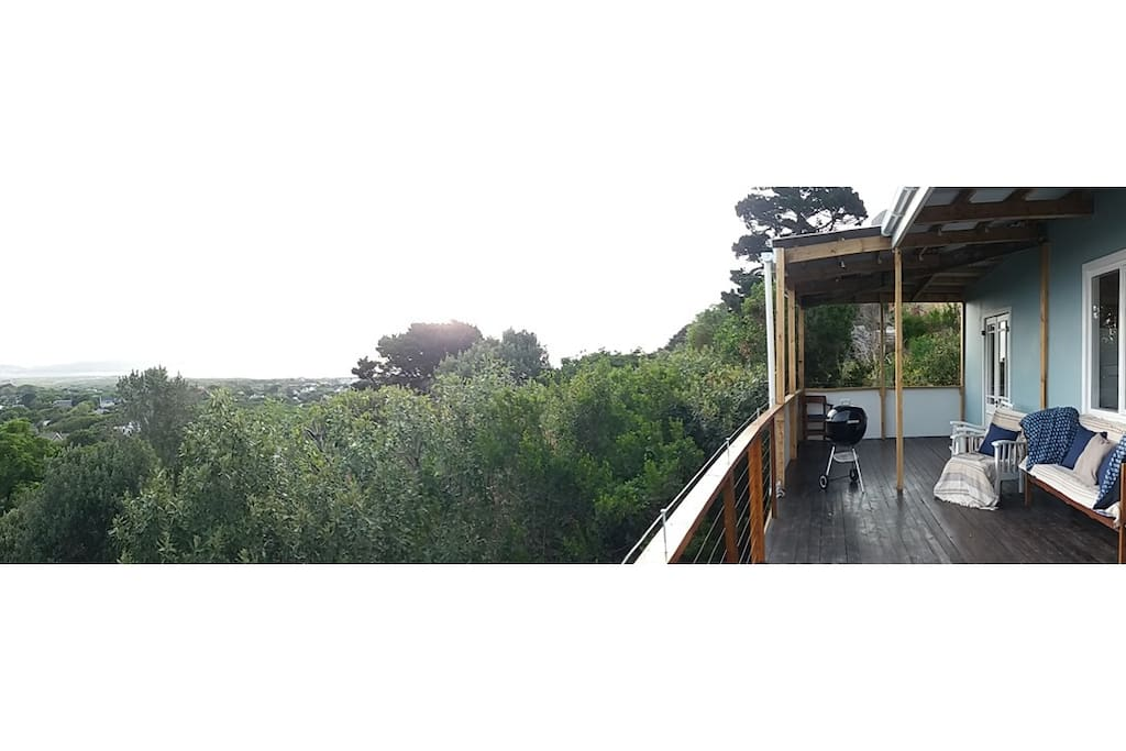 The cottage is hidden in between finebos and pine trees but with amazing views to Noordhoek beach and Chapmans peak