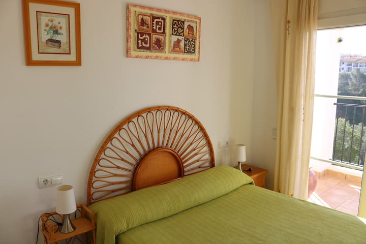 Spacious second bedroom with direct access to the main balcony