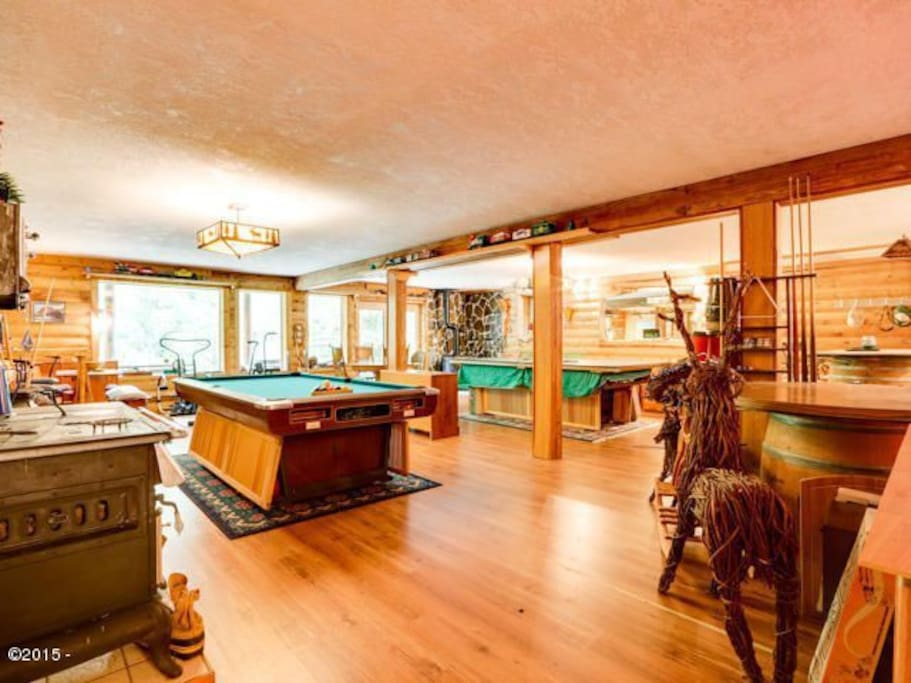 Basement is a game room and home gym. Complete with a Ping Pong table,  Billiards, and Shuffleboard