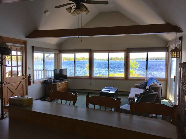 This is upstairs looking from the kitchen area to the lake.