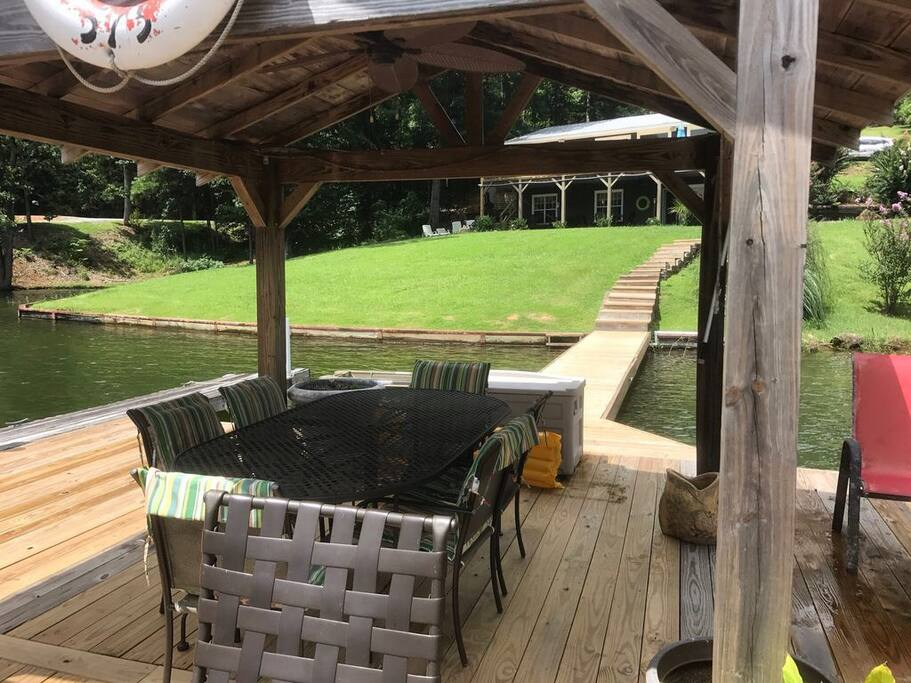 25 x 25 pier with gazebo, table and lounge chairs.
