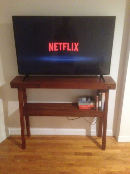 """48"""" flatscreen smart TV and premium cable channels."""