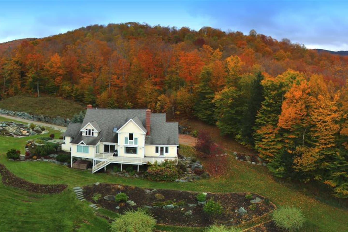 A house surrounded by fall foliage