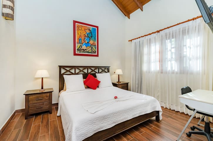 The bedroom features a big SUPER cozy bed for royal sleep, spacious wardrobe and air conditioner.