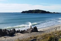 Beautiful Mt Maunganui beach looking out to Leisure Island.