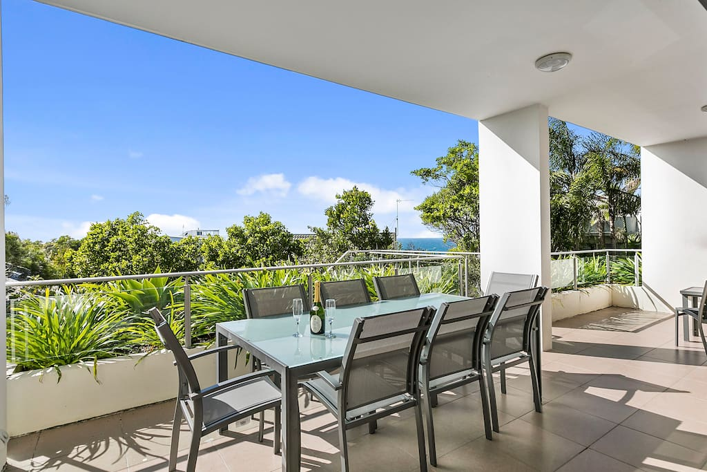 Alfresco dining with a lovely bit of ocean blue view