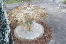 Tiki hut ground-floor and outdoor fire pit