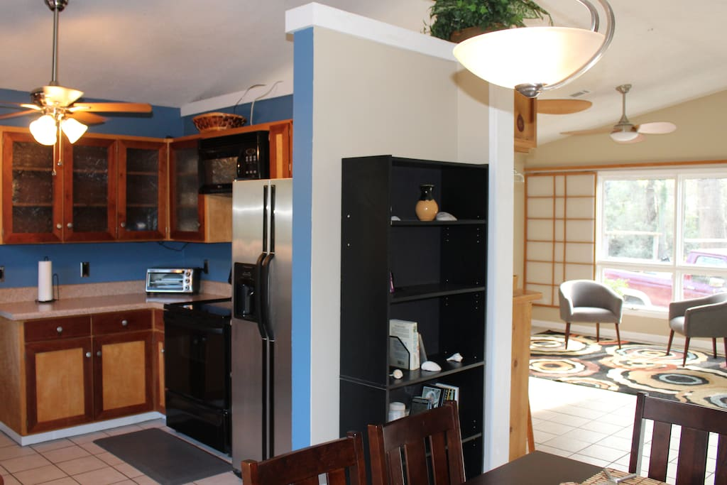 Stainless Steel refrigerator with Ice Maker, plenty of cabinets and stocked kitchen for cooking your favorite meals!