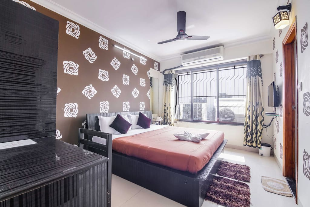 Spacious Master Bedroom with AC, LED TV, Wardrobe, Study Table and attached Western Style Washroom with separate wet/dry areas