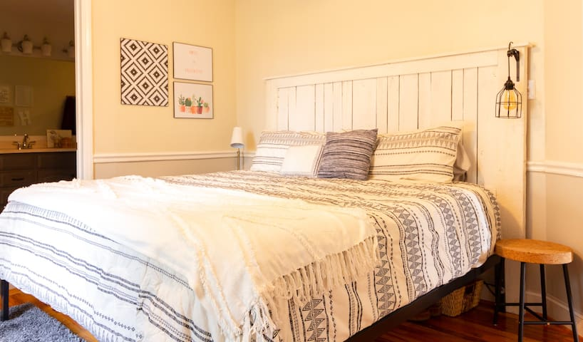 The king bed is comfortable and medium/soft range in firmness. The headboard was made by Calvin out of old barn wood.