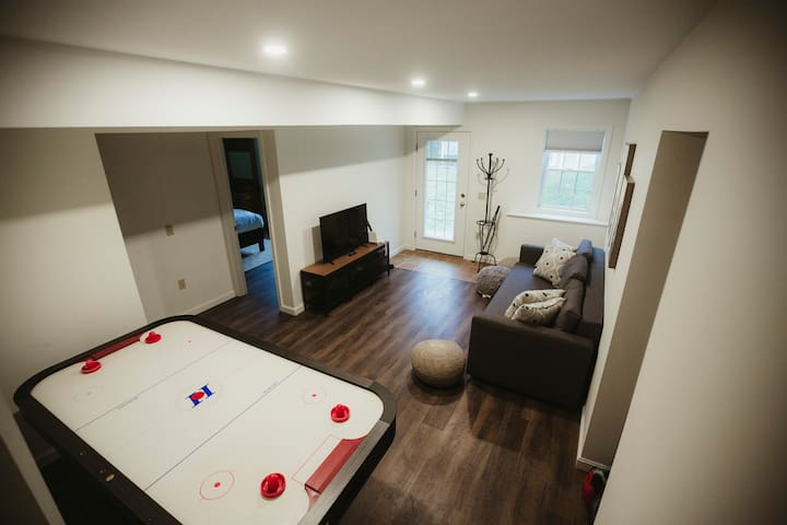 The downstairs living room has a pull-out sofa bed, a large air hockey table, and a Wii system with tons of games