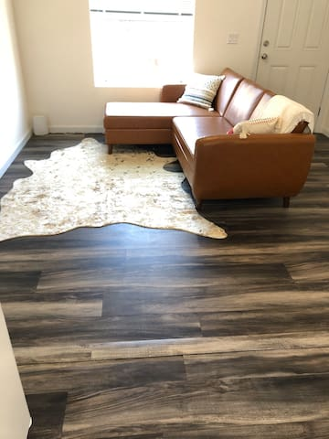 Sofa and rug. Includes large  TV with. Netflix (not currently shown)