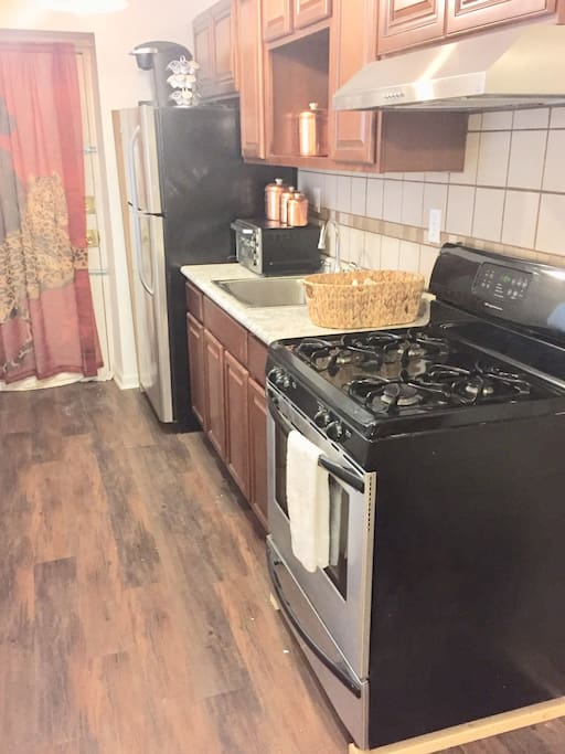 New full kitchen with stainless steel appliances.