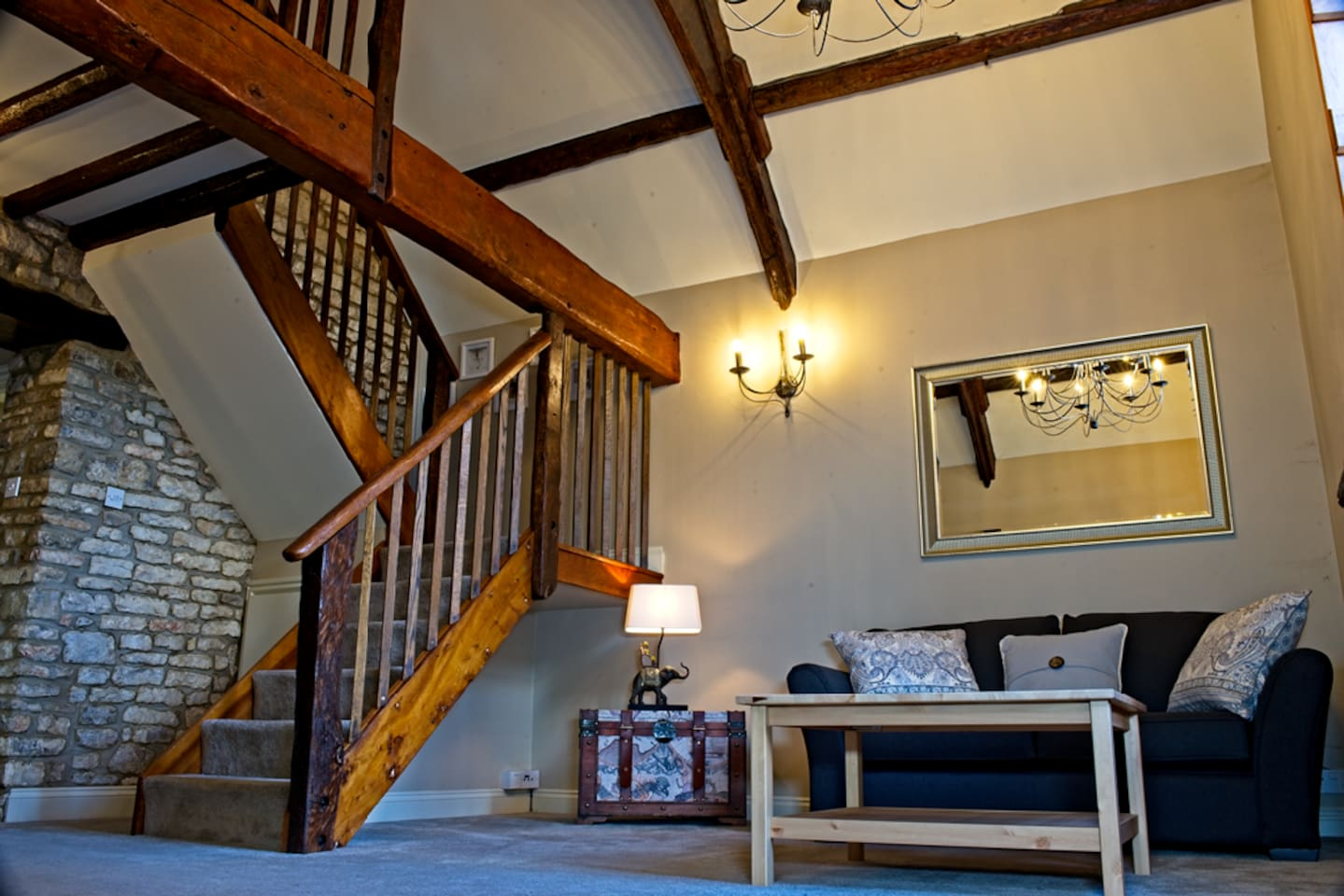 Sitting room with vaulted ceiling and original oak beams