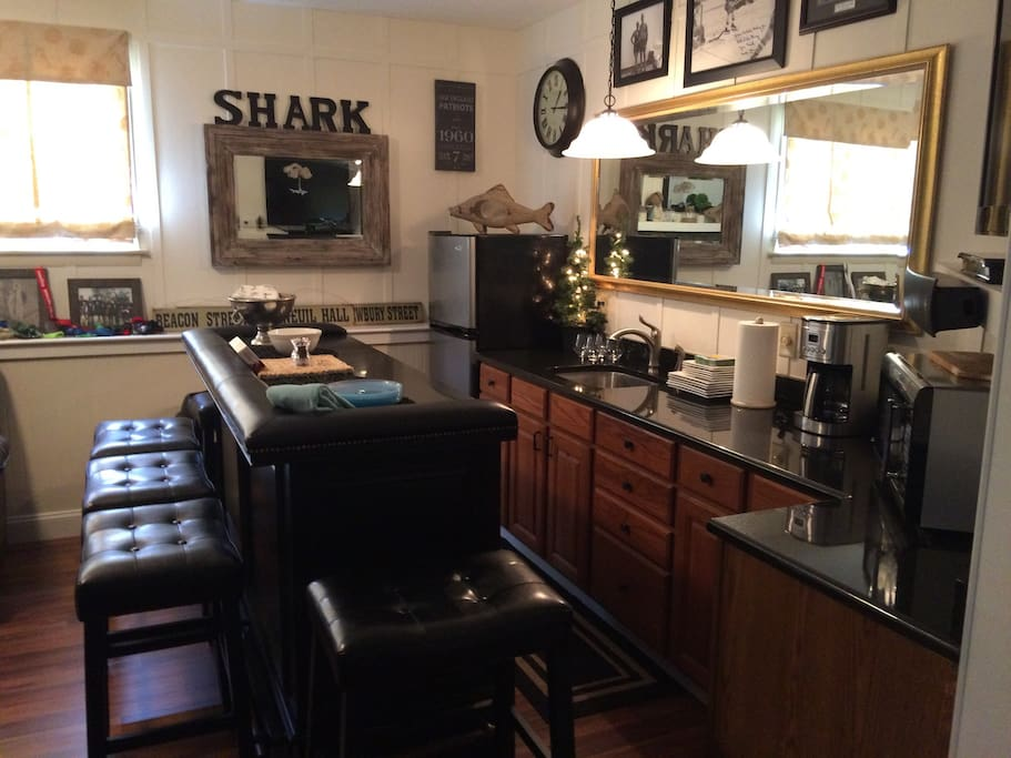 Wet bar with Netflix, frig, microwave and coffee machine. Fully stocked with plates and silverware.