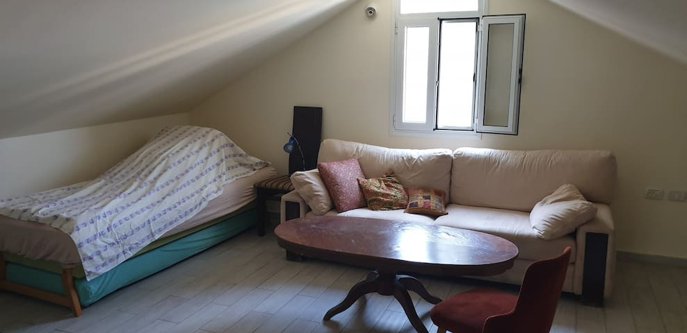 Two sofa in the third floor. No door, but in a private isolate part of the house
