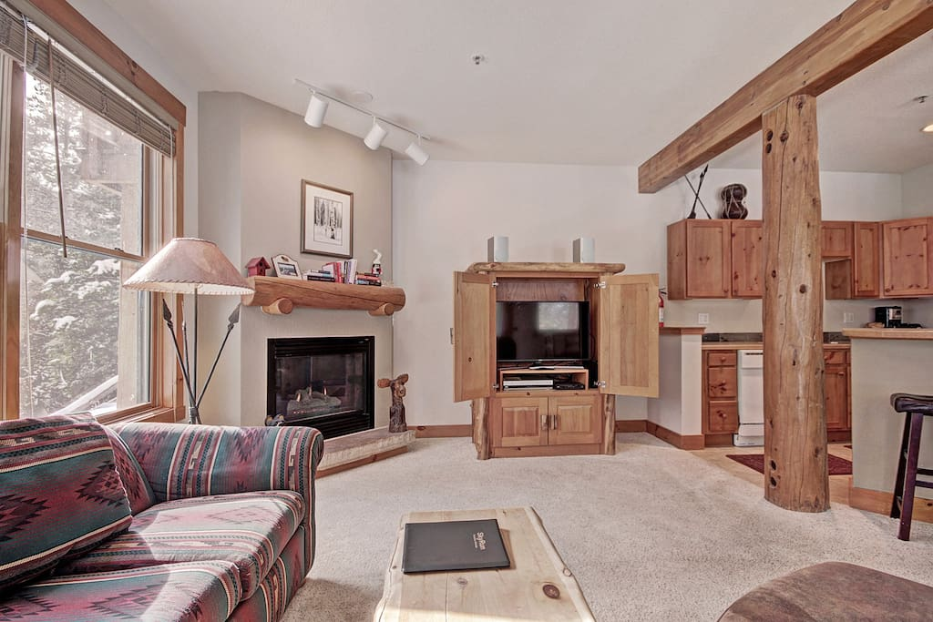 Living Room - Gas fireplace and flat-screen TV.