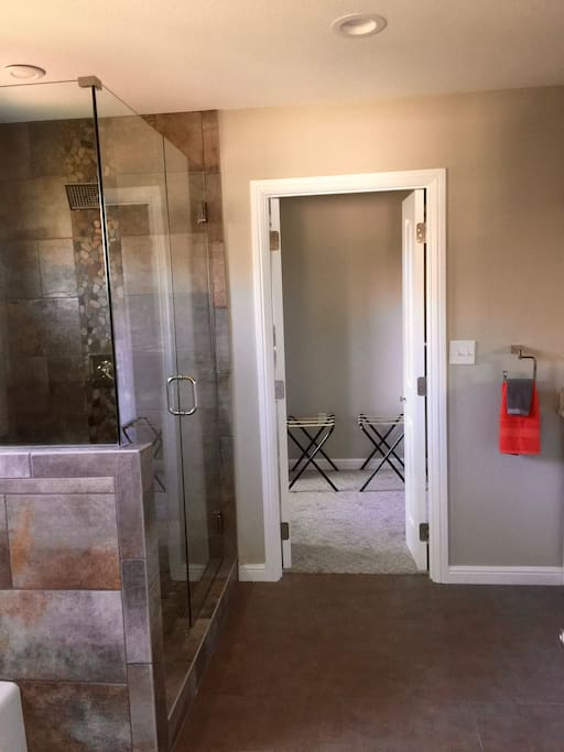 bath has tub and shower, large closets