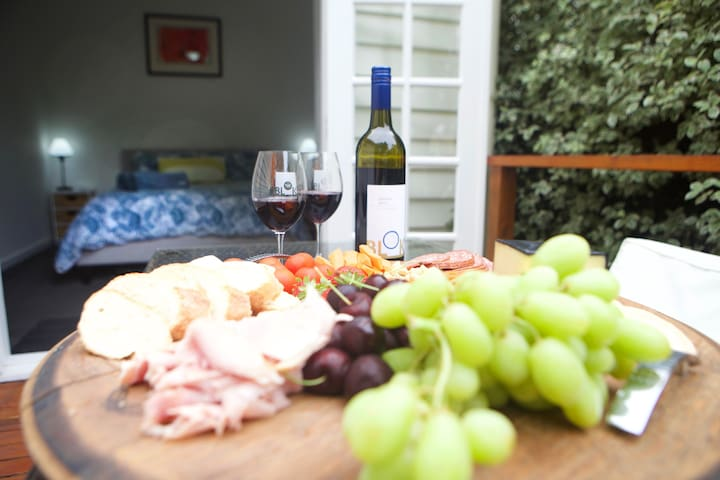Enjoy a delicious cheese platter and some wine on the timber decking