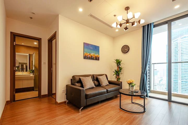 Living room has full sofa + table, connecting to the balcony so you can enjoy the light and view in day time. There're lovely and elegant decor with classy wooden floor and bright ceiling light.