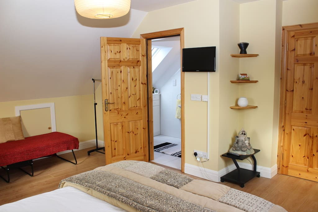Bedroom 1 with single bed and showing entrance to En Suite