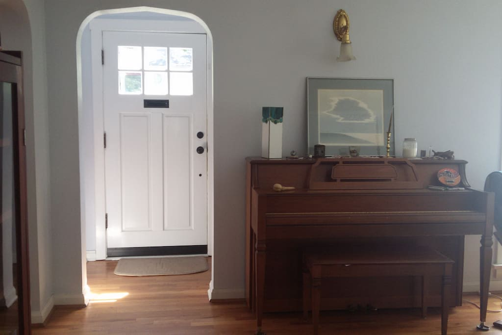 Entry Way showing the piano in the Living Area