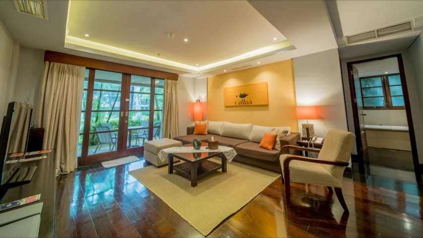 Spacious living room with a view to the main garden.