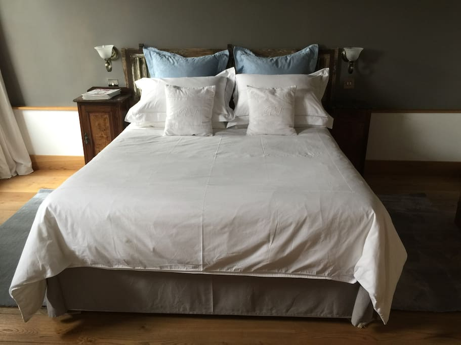 Spacious king-size bed with crisp white cotton sheets