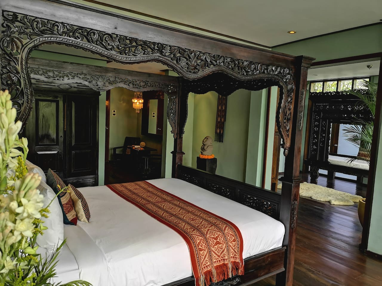 Antique Balinese handcarved bed, with Italian Mattress and heirloom quality textiles. Details & crystals.