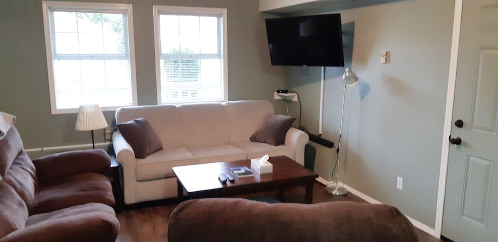 Comfortable living room, with smart tv,  queen size pullout sofa, and very comfy reclining chair and couch