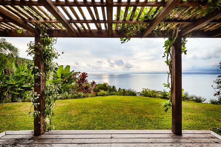 Each of our four bungalows opens to a private veranda overlooking Savusavu Bay.