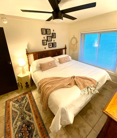 Middle bedroom with king bed and luxurious linens