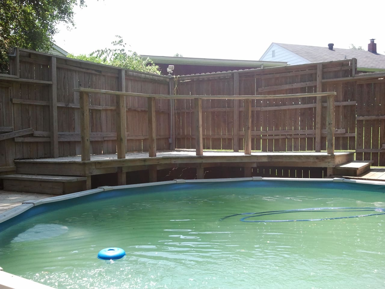Pool and 4 level Deck with privacy fencing all around. Looks better when umbrellas and furniture is in place.