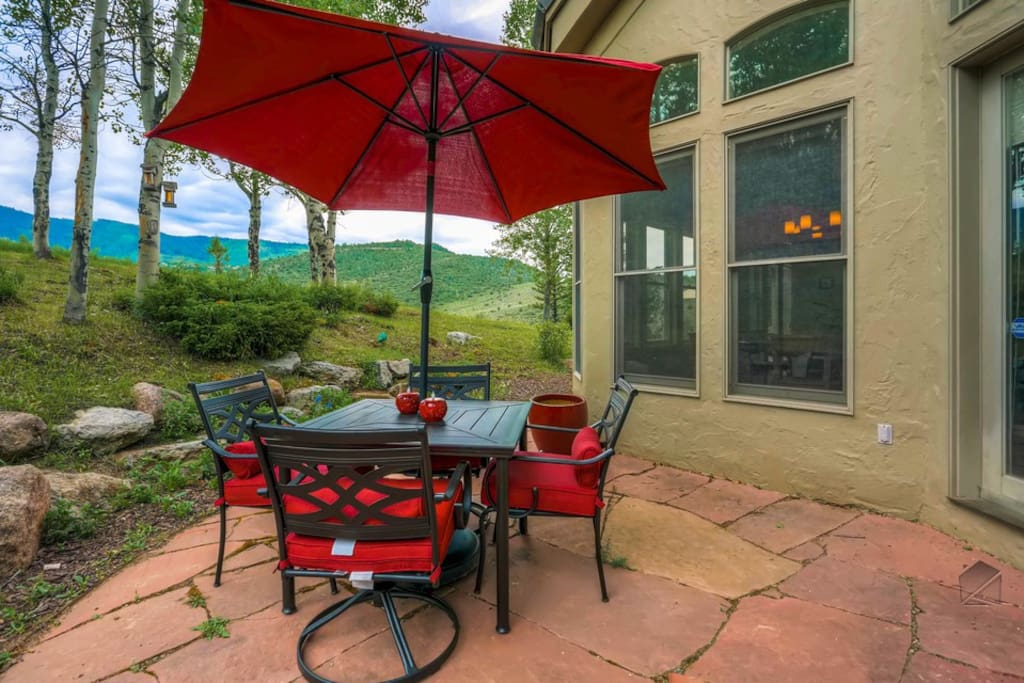 The outside dining patio offers mountain views and showcases how serenity reigns supreme.