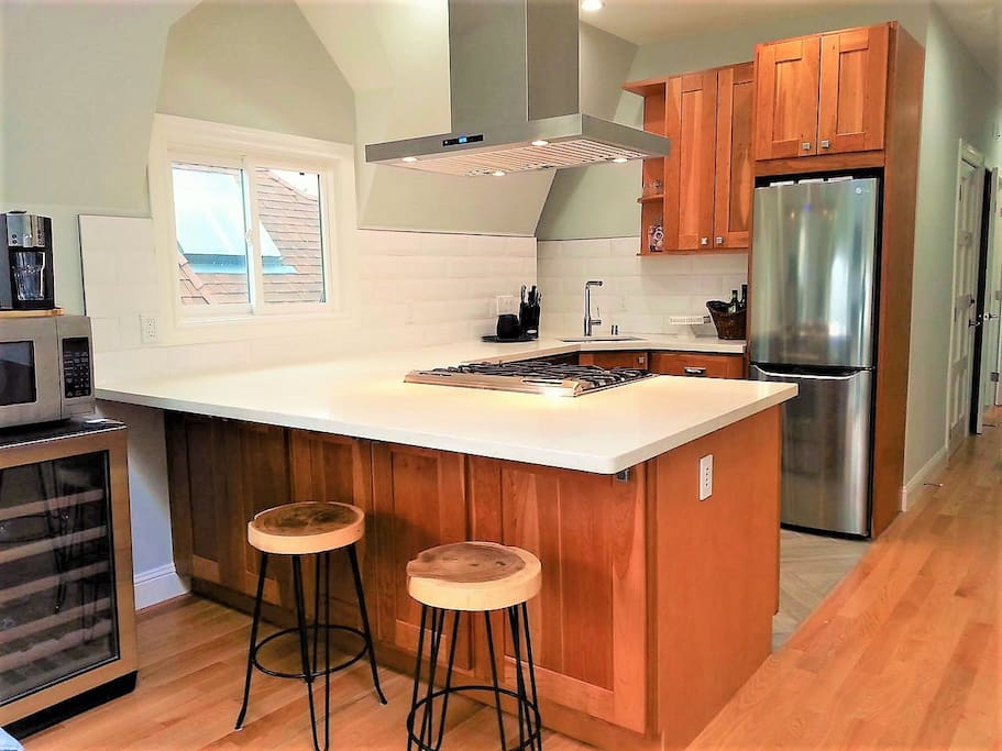 Brand new kitchen remodel with all stainless steel appliances. Fully stocked kitchen essentials for your cooking needs.