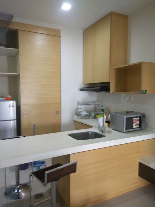 Kitchen cabinet, oven, fridge, washing machine,