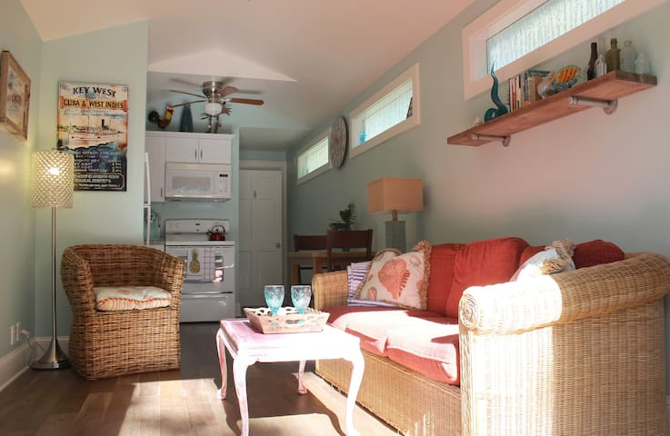 Cozy cottage, with rear bedroom for privacy and quiet. French doors let lots of light and breeze in.