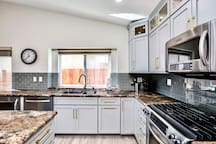 Trendy gray-color of kitchen cabinet highlighted with gold-color knobs