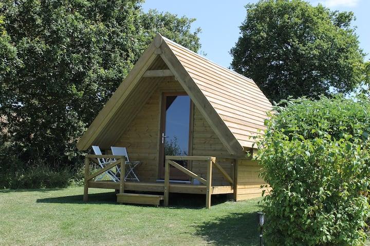 Cabane en bois au coeur de la nature