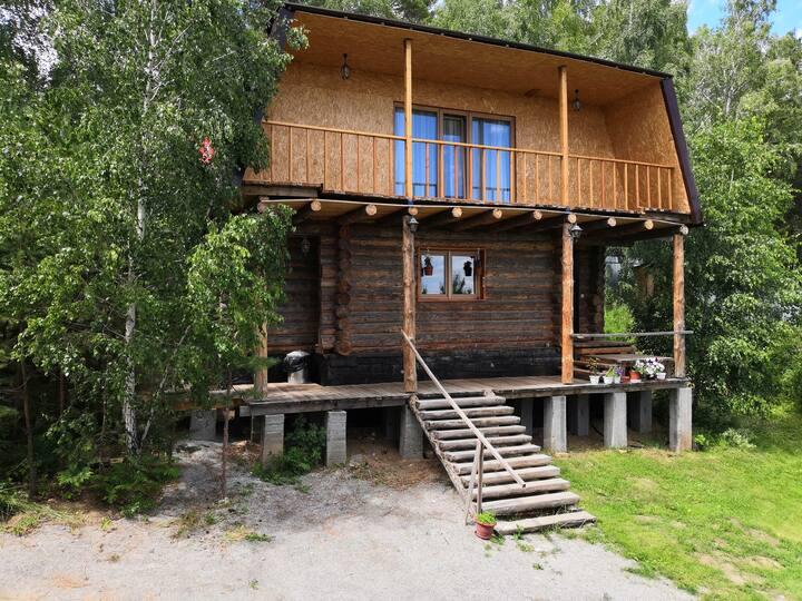 Уютный дом в п. Вишневогорск с прекрасным видом.