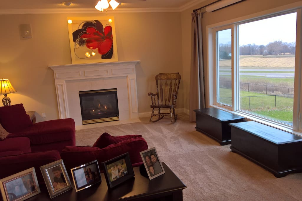 Comfortable main floor family room with gas fireplace doubles as a home theater.