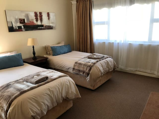 Guest room equipped with two single beds for the kids with breathtaking views.
