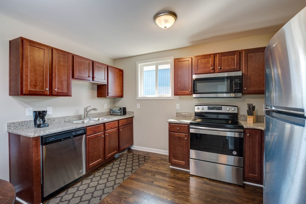 Spacious kitchen is stocked with a starter supply of dish soap and paper towels.