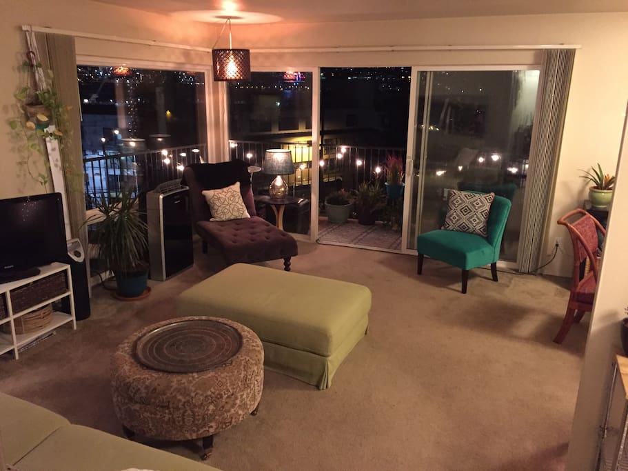 Living room. Comfortable seating for 5+ ppl. Floor to ceiling Windows and breathtaking view of the Seattle city skyline.